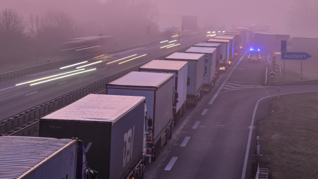Trucks are jammed in the early morning on Autobahn 12 in front of the German-Polish border crossing near Frankfurt (Oder), Germany, Wednesday, March 18, 2020. In order to make it more difficult for the corona virus to spread, Poland had reintroduced controls at the border crossings to Germany. (Patrick Pleul/dpa via AP)