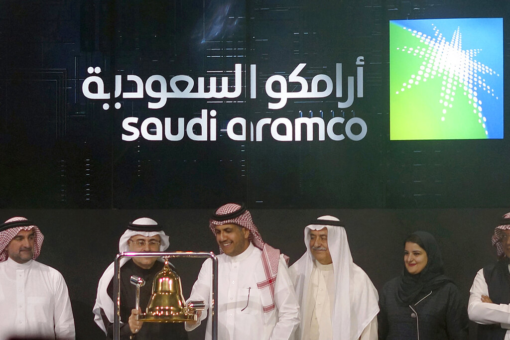 FILE - In this December 11, 2019, file photo, Saudi Arabia's state-owned oil company Armco and stock market officials celebrate during the official ceremony marking the debut of Aramco's initial public offering (IPO) on the Riyadh's stock market, in Riyadh, Saudi Arabia. (AP Photo/Amr Nabil, File)