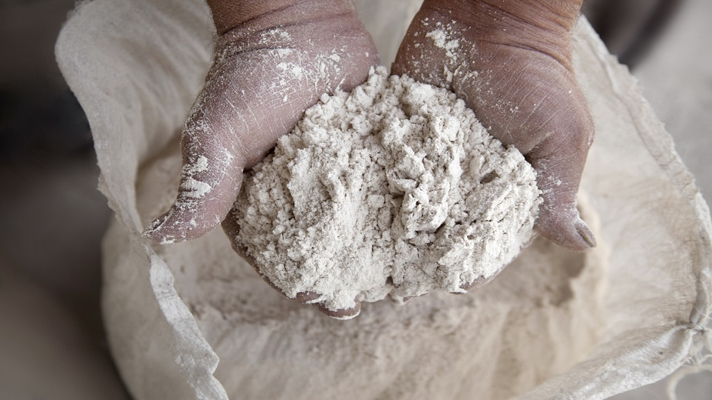 iStock photo of a handful of flour.