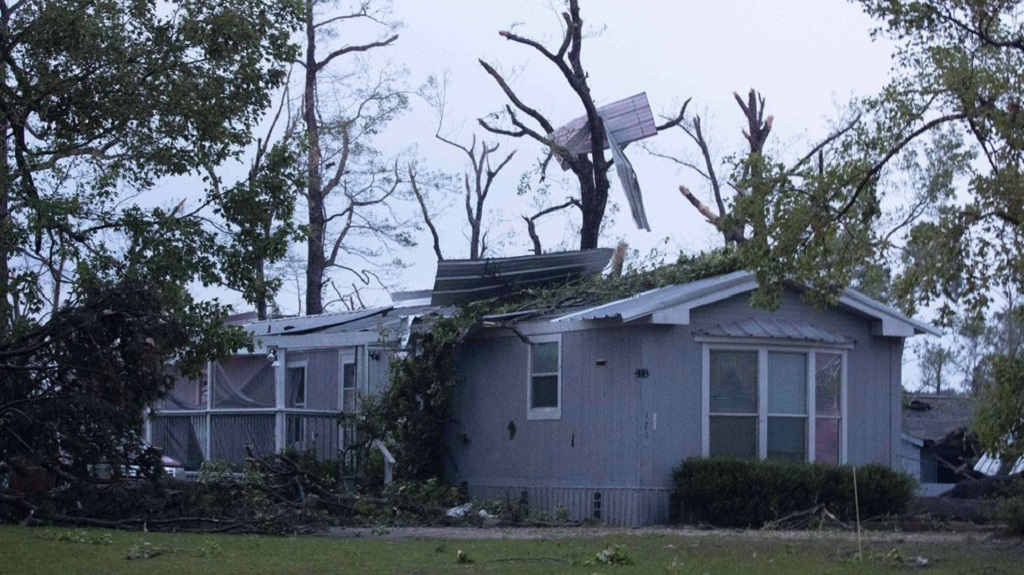 A damaged home is seen after an apparent tornado touched down Wednesday, April 22, 2020, in Onalaska, Texas. (Jason Fochtman/Houston Chronicle via AP)