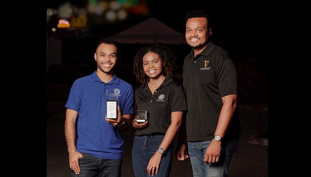 (From left) Dancehall Cyan Stall! Director of ESRIOM, Alex Morrissey, holds the official ADDY Award for the Consumer Website Category. Pictured beside him are ESIROM Digital Systems Specialist Tajé Carter (who holds the individual award) and Guinness Jamaica Brand Manager Nathan Nelms.