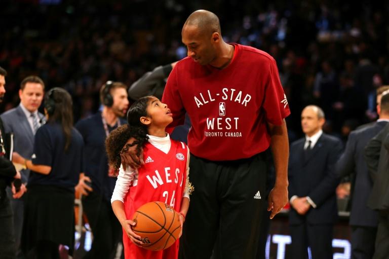 Kobe Bryant et sa fille Gianna lors du All Star Game 2016, le dernier de sa carrière, le 14 février 2016 à Toronto