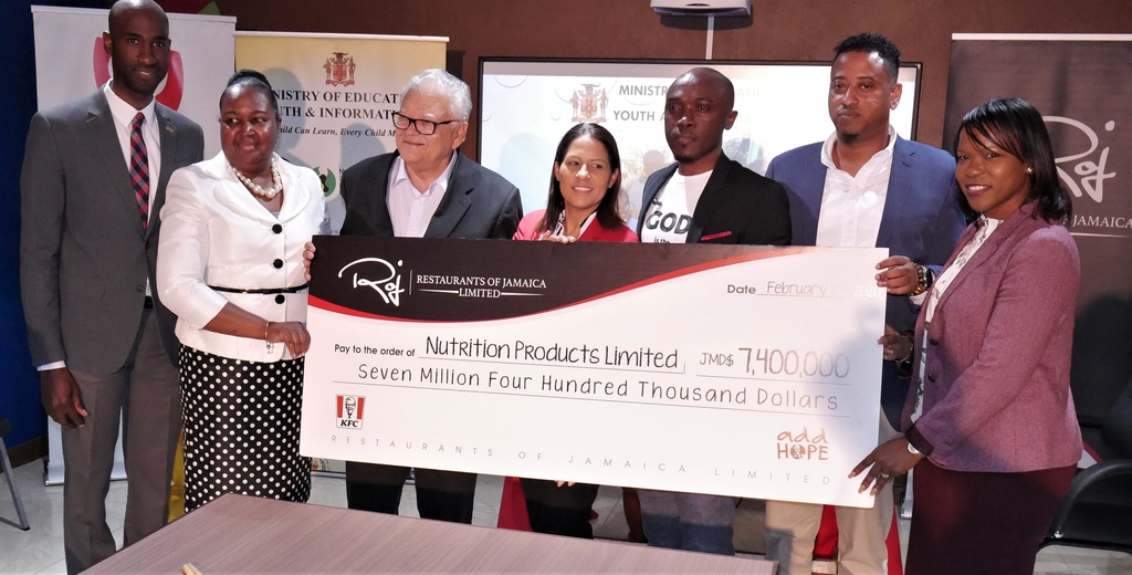 From left to right: Andrei Roper, Brand Manager, ROJ; Dr. Grace McLean, Acting Permanent Secretary, MOEYI; Karl Samuda, Minister without Portfolio, MOEYI; Tina Matalon, Marketing Director, ROJ; Kevin Downswell,  Gospel Artiste and KFC Add Hope Brand Ambassador; Andrew Narine, CEO of NPL; and Dr Kasan Troupe, Acting Chief Education Officer, MOEYI.
