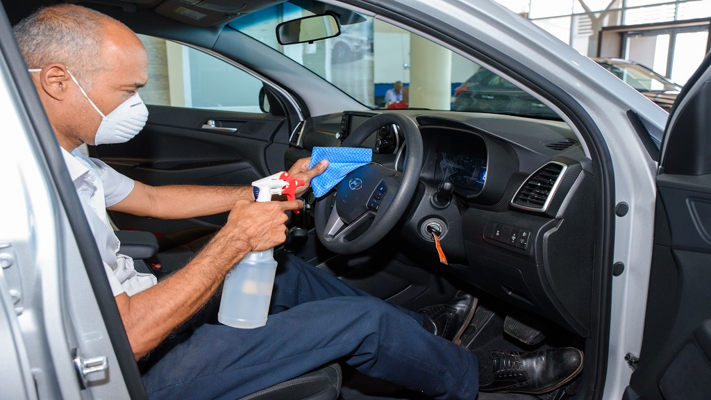 Gary Ingram, client advisor at Magna Motors Dealership Limited, cleans the steering wheel of a 2020 Tucson.