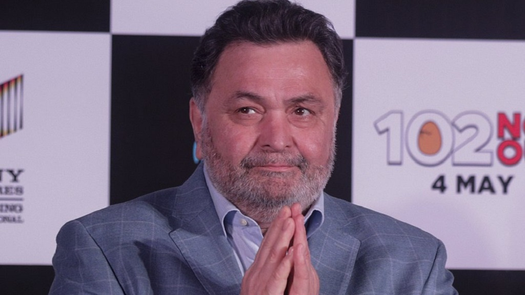 FILE- In this April 19, 2018 file photo, Bollywood actor Rishi Kapoor greets media as he arrives for the song launch of film '102 Not Out' in Mumbai, India. Rishi Kapoor, a top Indian actor and a scion of Bollywood's most famous Kapoor family, has died after a battle with cancer. He was 67.(AP Photo/Rafiq Maqbool, File)