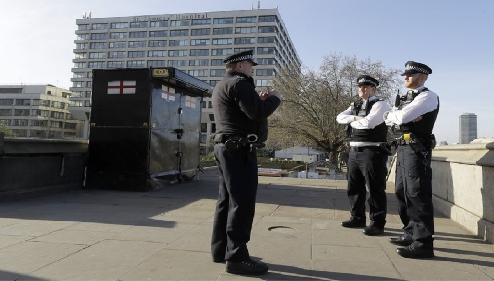 Police officers stand outside St Thomas' Hospital in central London as British Prime Minister Boris Johnson was moved to intensive care after his coronavirus symptoms worsened in London, Tuesday, April 7, 2020. Johnson was admitted to St Thomas' hospital in central London on Sunday after his coronavirus symptoms persisted for 10 days. (AP Photo/Kirsty Wigglesworth)