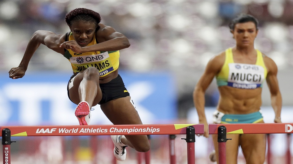 Danielle Williams of Jamaica, left, powers to victory in heat three of the women's 100m hurdles heat at the World Athletics Championships in Doha, Qatar, Saturday, Oct. 5, 2019. (AP Photo/Petr David Josek).