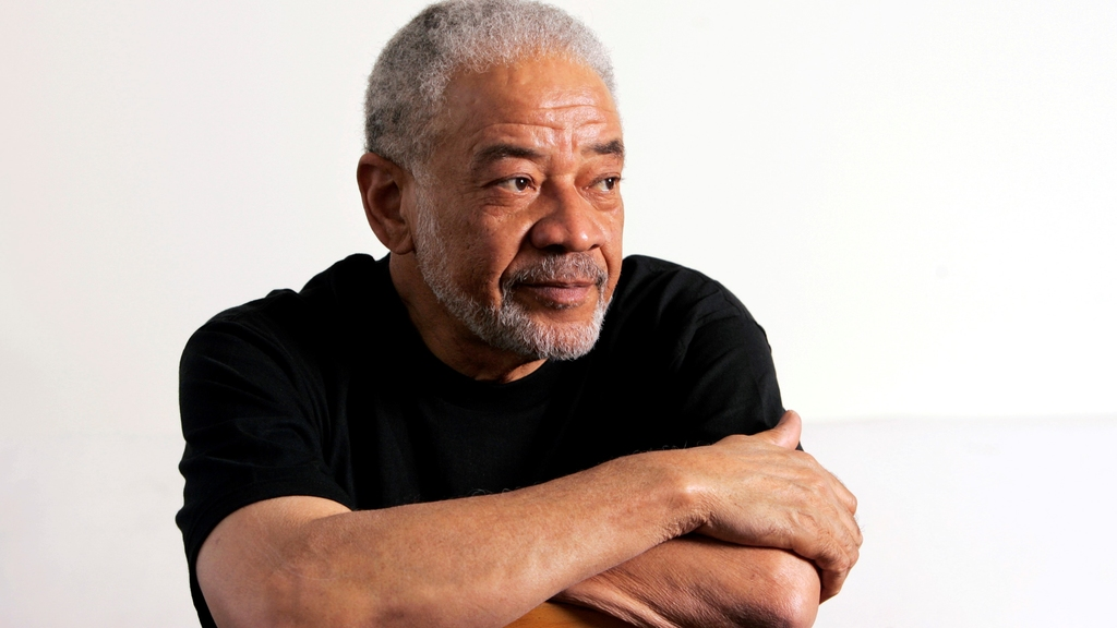 "n this June 21, 2006 file photo, singer-songwriter Bill Withers poses in his office in Beverly Hills, Calif. Withers, who wrote and sang a string of soulful songs in the 1970s that have stood the test of time, including ""Lean On Me,"" ""Lovely Day"" and ""Ain't No Sunshine,"" died in Los Angeles from heart complications on Monday, March 30, 2020. He was 81. (AP Photo/Reed Saxon, File)"