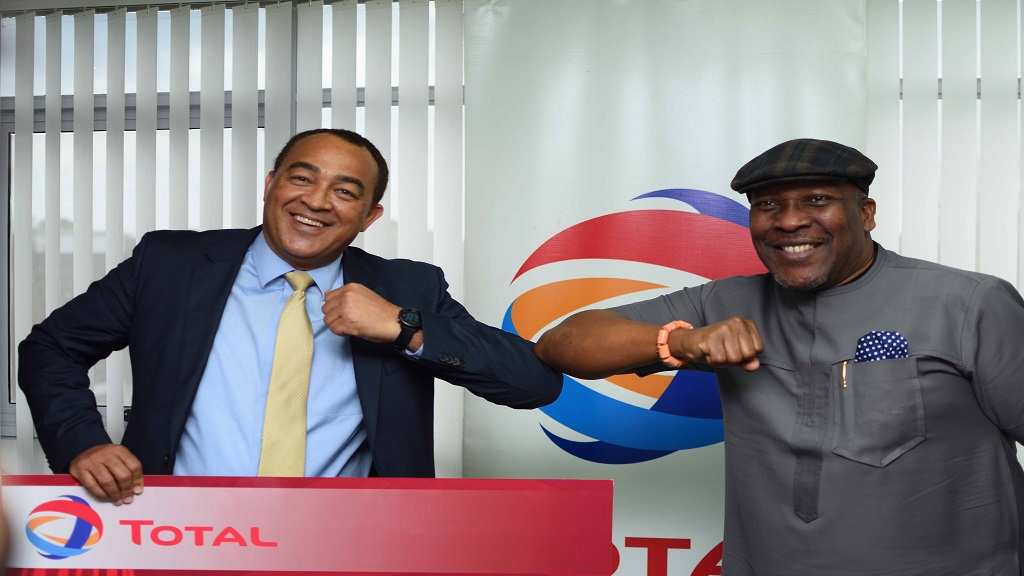 Health minister, Dr Christopher Tufton (left), and Chris Okonmah, Total Jamaica's managing director and chief executive officer, practise the elbow bump, the internationally accepted way of greeting, replacing the handshake, since the coronavirus pandemic swept the world.