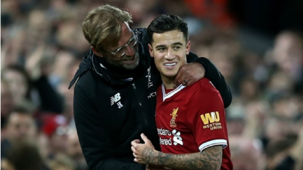 Liverpool boss Jurgen Klopp (left) and  Philippe Coutinho.