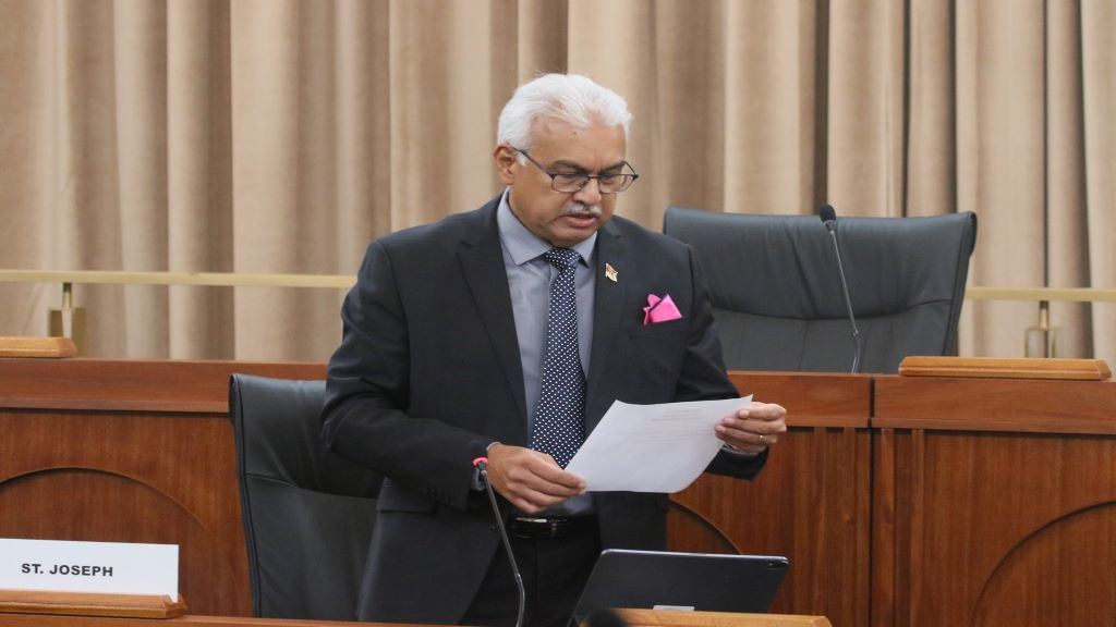 Minister of Health Terrence Deyalsingh, lays a paper during the 22nd sitting of the House of Representatives. © 2020 Office of the Parliament.