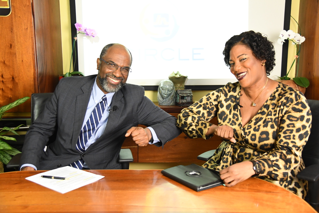 . Earl Jarrett (left), chief executive officer of The Jamaica National Group greets Dahlia Harris, host of the 'JN Circle Catch Up', a video series of conversations about how Jamaicans can come together, to overcome various elements of the COVID-19 pandemic.