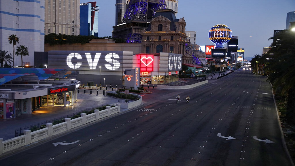 The Las Vegas Strip is deserted as casinos and other business are closed because of the coronavirus outbreak, Tuesday, April 14, 2020, in Las Vegas. (AP Photo/John Locher)