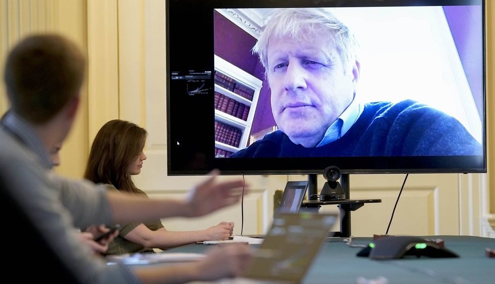FILE - In this Saturday, March 28, 2020 handout photo provided by Number 10 Downing Street, Britain's Prime Minister Boris Johnson chairs the morning Covid-19 Meeting remotely after self isolating after testing positive for the coronavirus, at 10 Downing Street, London. British Prime Minister Boris Johnson has been admitted to a hospital with the coronavirus. (Andrew Parsons/10 Downing Street via AP, File)
