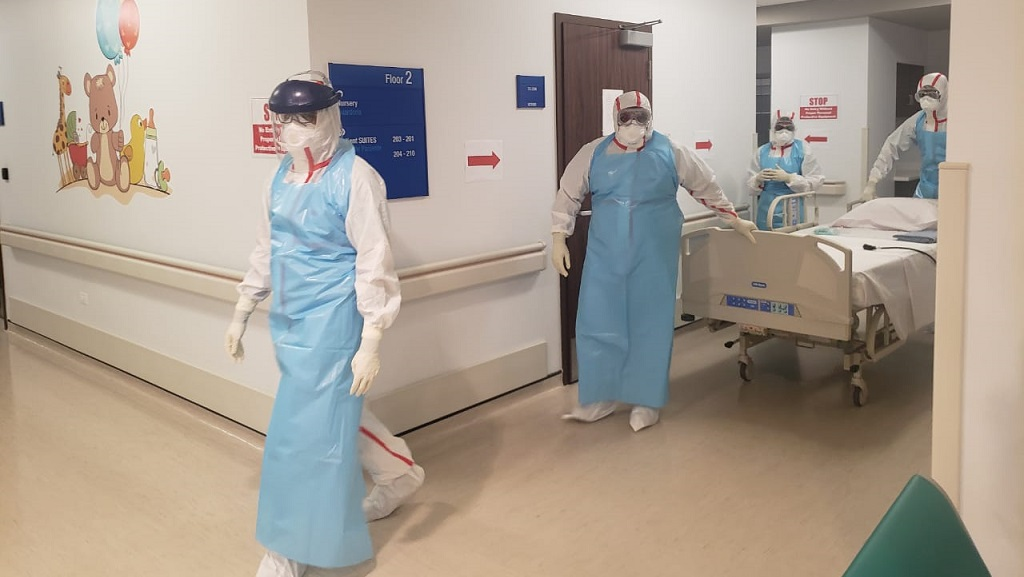 Photo: Healthcare workers in full PPE carry out drills at the Caura Hospital. Photo courtesy the NCRHA.
