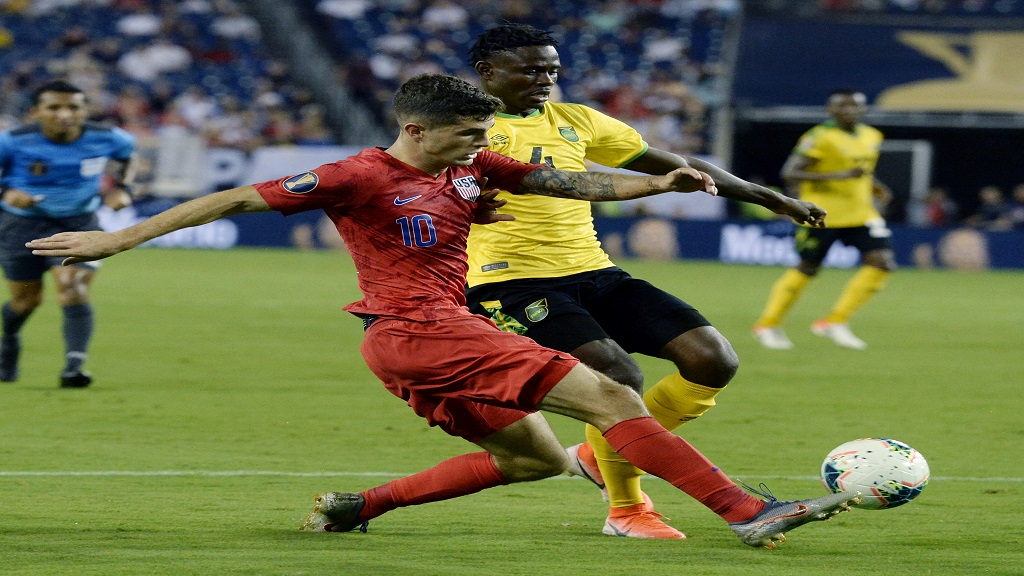 Jamaica midfielder Andre Lewis (right) and United States midfielder Christian Pulisic fight for possession during their Concacaf Gold Cup semifinal football match on Wednesday, July 3, 2019, in Nashville, Tenn. The United States won 3-1.