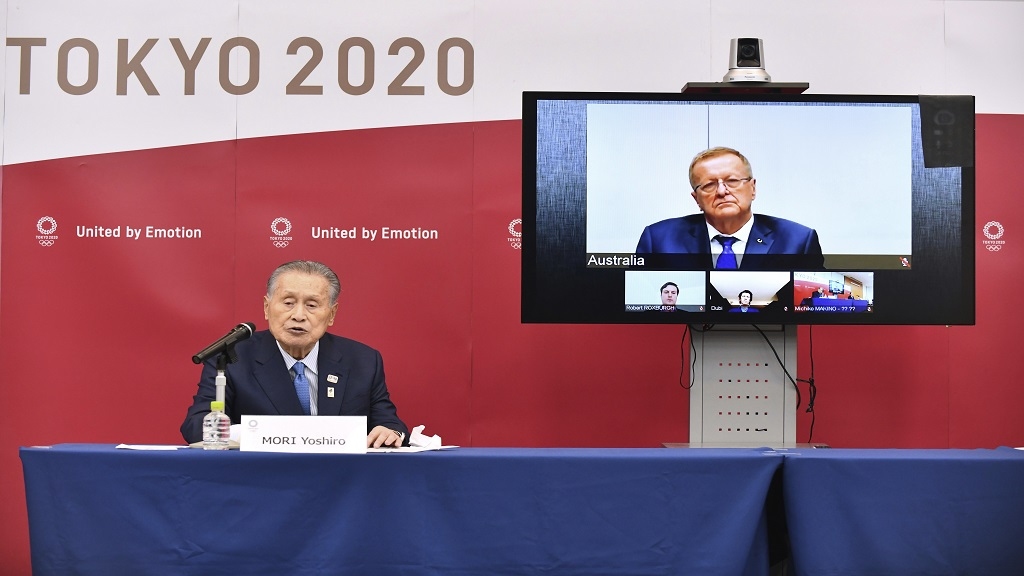 In this April 16, 2020, file photo, Tokyo 2020 Organising Committee President Yoshiro Mori, left, speaks in teleconference with John Coates, chairman of the IOC's Coordination Commission for the Tokyo 2020 Olympic Games, in Tokyo. (Kazuhiro Nogi/Pool Photo via AP, File).