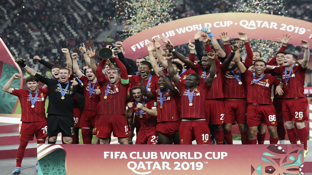 Players of Liverpool celebrate after winning the Club World Cup final against Flamengo at Khalifa International Stadium in Doha, Qatar, Saturday, Dec. 21, 2019. (AP Photo/Hassan Ammar).
