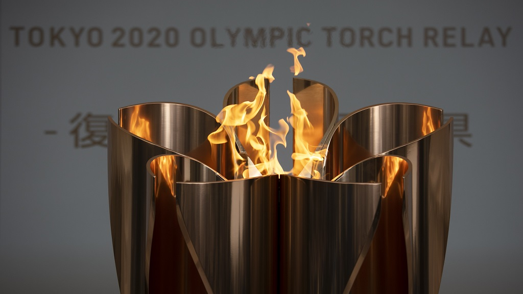 In this March 24, 2020, file photo, the Olympic Flame burns during a ceremony in Fukushima City, Japan.  (AP Photo/Jae C. Hong, File).