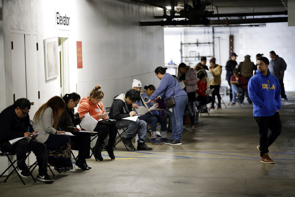 More than 6.6 million Americans applied for unemployment benefits last week, far exceeding a record high set just last week, a sign that layoffs are accelerating in the midst of the coronavirus. (AP Photo/Marcio Jose Sanchez, File)