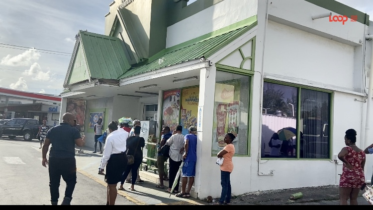 Scores of Barbadians lined up at Trimart Supermarket Rendezvous.