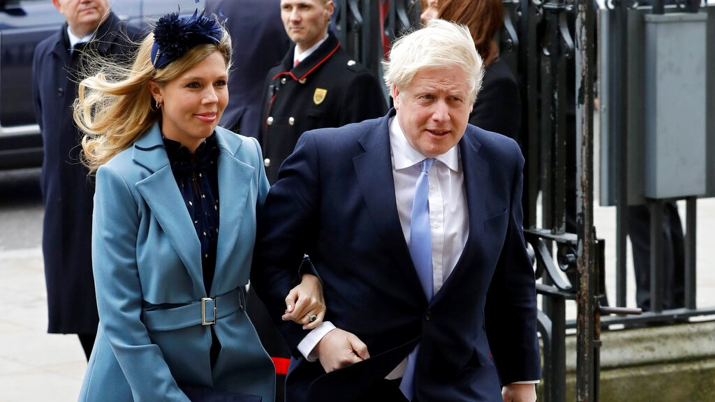 In this Monday, March 9, 2020 file photo Britain's Prime Minister Boris Johnson and his partner Carrie Symonds arrive to attend the annual Commonwealth Day service at Westminster Abbey in London. (AP Photo/Kirsty Wigglesworth, File)