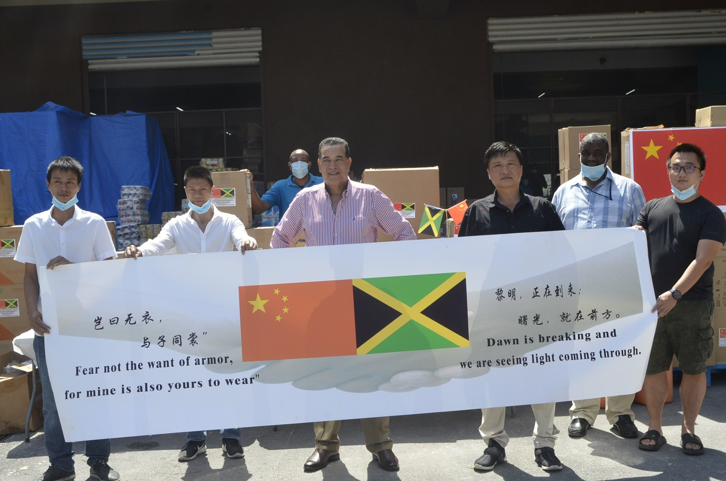 Montego Bay Mayor, Homer Davis (centre, foreground), and members of the Montego Bay Chinese business community in the western city on Friday.