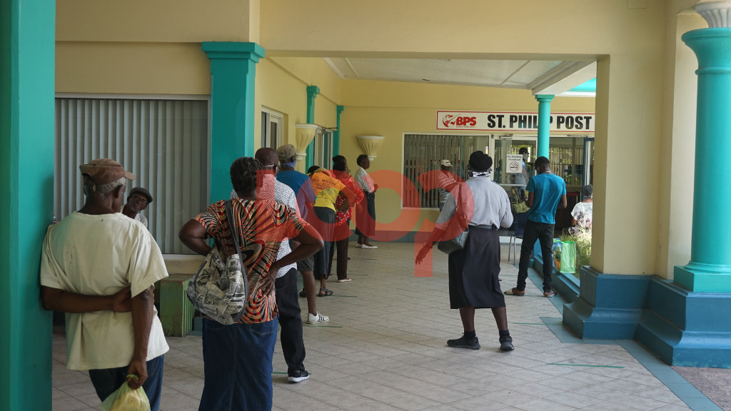Patrons line up to get cheques cashed at St. Philip Post Office