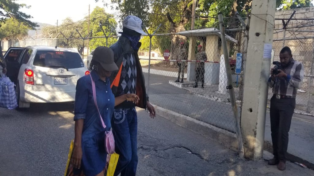 Two deportees leave the