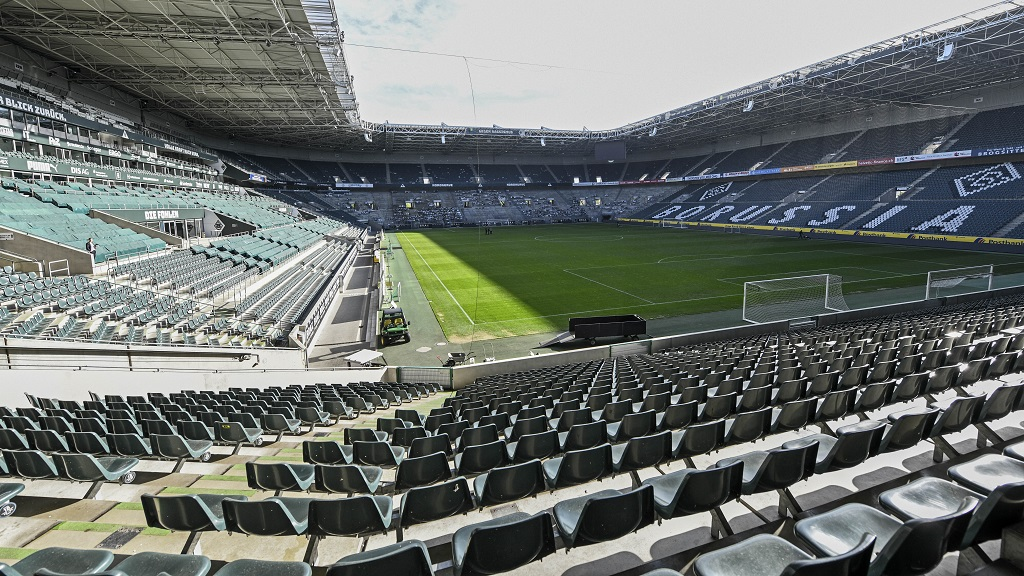 Empty seats are pictured at the stadium of German Bundesliga football club Borussia Moenchengladbach in Moenchengladbach, Germany, Thursday, April 16, 2020. All major events in Germany are suspended due to the coronavirus outbreak until the end of August, the German Bundesliga suspended all matches until April 30, 2020. (AP Photo/Martin Meissner).