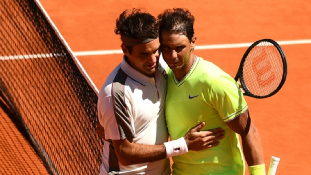 Rafael Nadal (right) and Roger Federer embrace after their French Open semi-final.