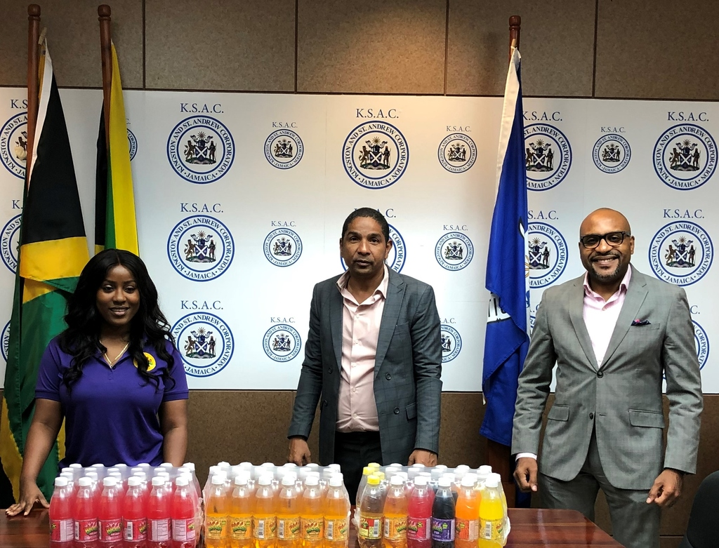 L-R: Bigga Brand Manager, Keteisha McHugh; His Worship the Mayor, Senator Councillor Delroy Williams and Kingston and St Andrew Municipal Corporation (KSAMC) Town Clerk, Robert Hill. The three were pictured at the KSAMC's Church Street offices on Wednesday, April 8, 2020 following Wisynco Group Limited's donation of almost 5,000 600 ml BIGGA Soft Drinks.