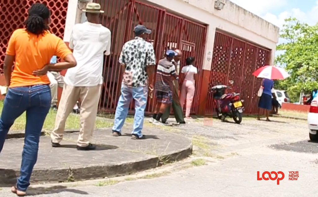 Persons lined up all around St Thomas Post Office on April 8. (FILE)
