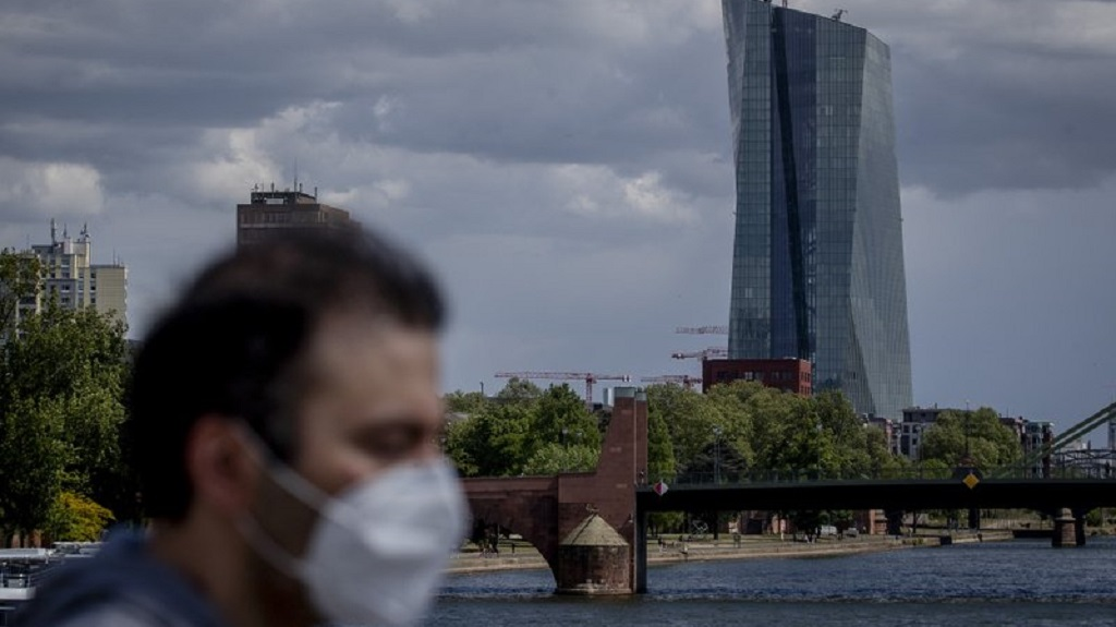 A man walks in front of the European Central Bank in Frankfurt, Germany, Wednesday, April 29, 2020. The ECB will have the meeting of the governing council on Thursday. (AP Photo/Michael Probst)