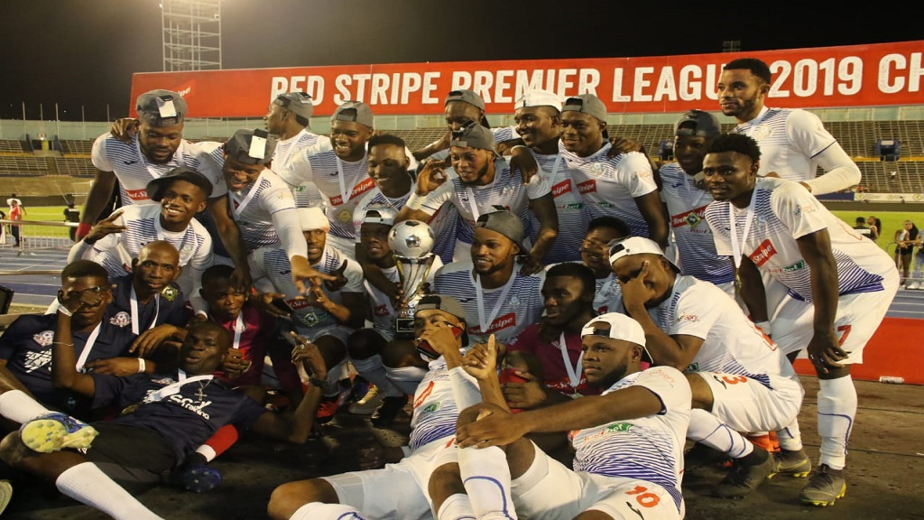 Portmore United's players pose with the Red Stripe Premier League trophy after beating Waterhouse 1-0 in the final on Monday, April 29, 2019 at the National Stadium. (PHOTOS: Llewelyn Wynter).