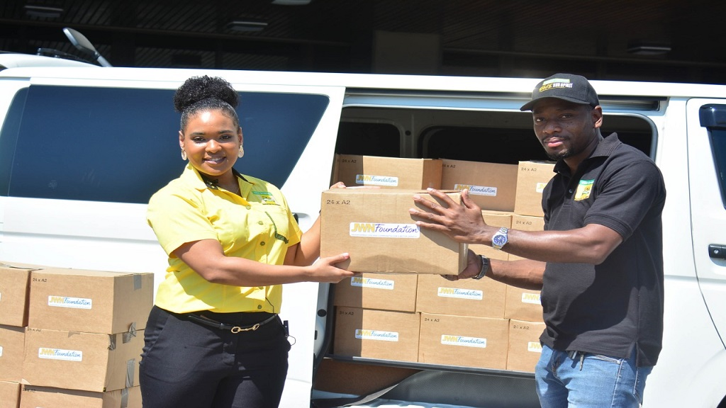 J Wray and Nephew workers with food packages for distribution nationally amid the ongoing COVID-19 pandemic.