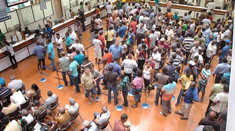 Taxpayers queue in lines to make payments