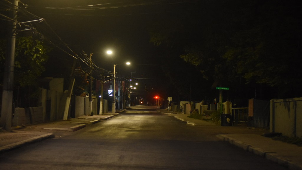 A deserted Corporate Area street on Wednesday during the first night of the nightly all-island curfew imposed to contain the spread of COVID-19 in Jamaica. (Photo: Marlon Reid)