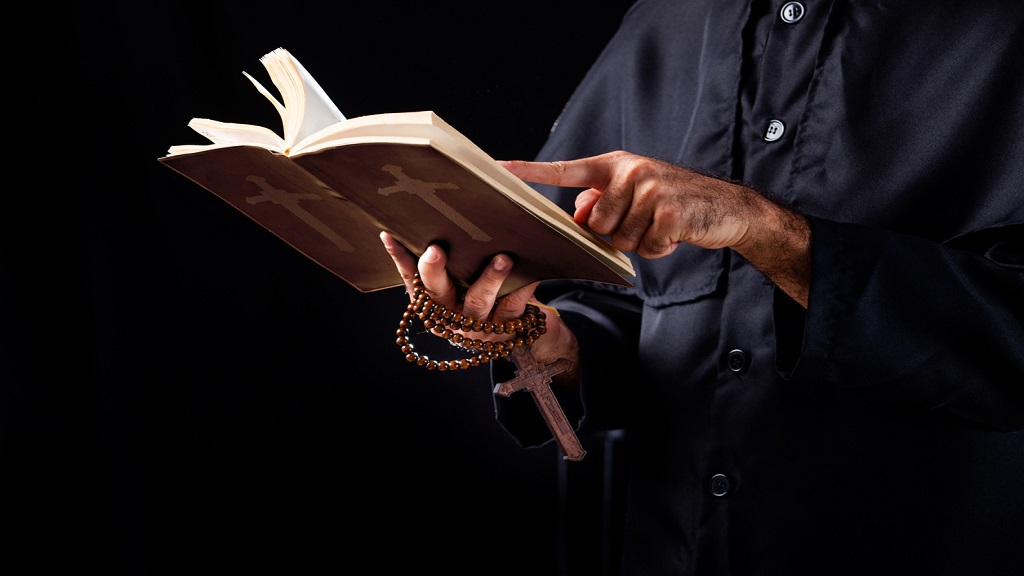 iStock photo of a pstor reading a bible.