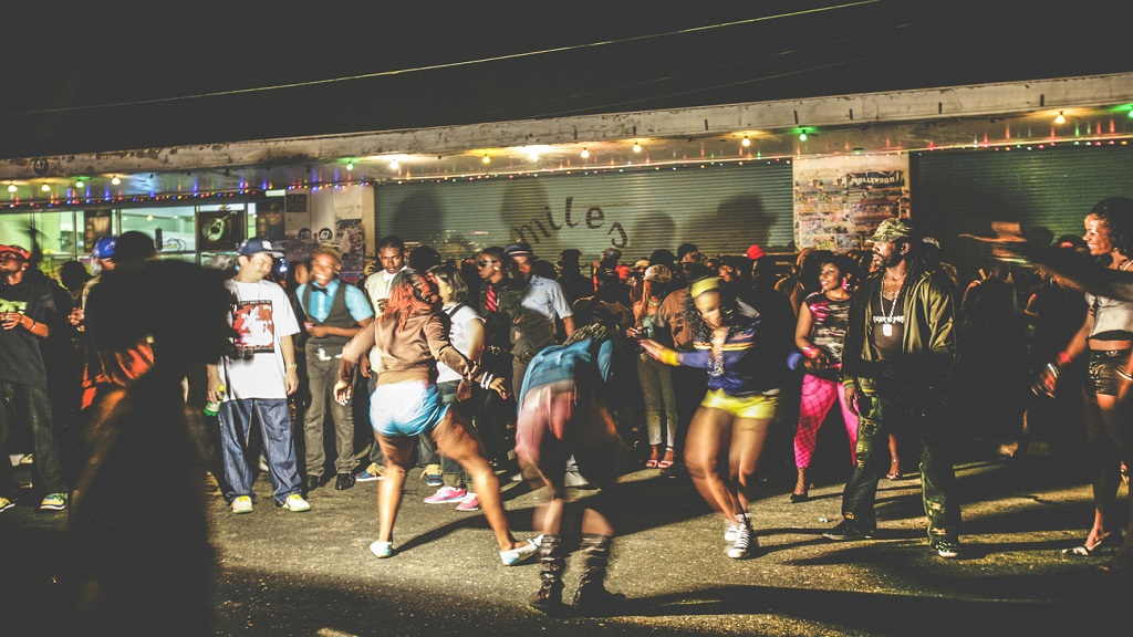 """iStock photo of a crowd enjoying dancehall music and dancing at the inner city """"Passa Passa"""" street party."""