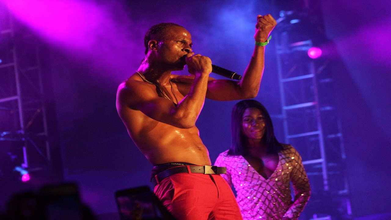 Dexta Daps performs at Reggae Sumfest Dancehall Night while actress Lady Ice looks on. (Photos: Marlon Reid)