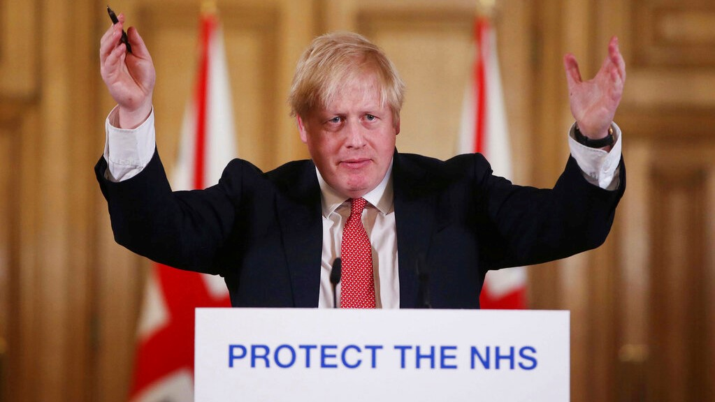 In this Sunday March 22, 2020 file photo British Prime Minister Boris Johnson gestures during his daily COVID 19 coronavirus press briefing to announce new measures to limit the spread of the virus, at Downing Street in London. (Ian Vogler / Pool via AP, File)