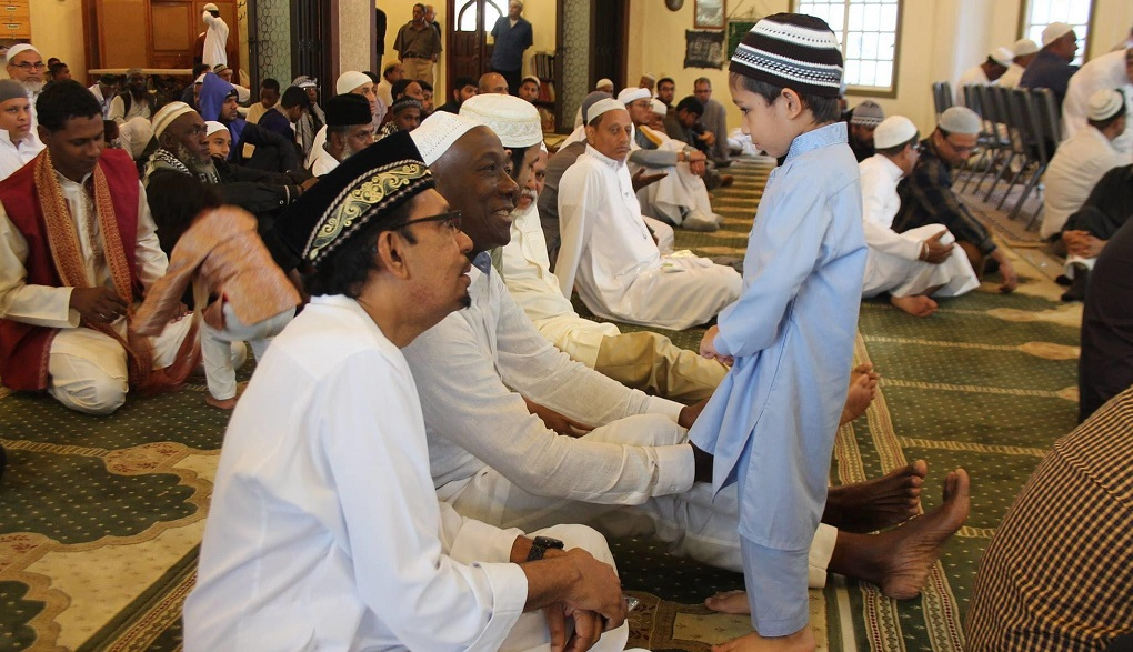 Prime Minister Dr Keith Rowley and Rural Development Minister Kazim Hosein speak with child inside mosque. Photo posted to Dr Keith Rowley's Facebook page in 2019.