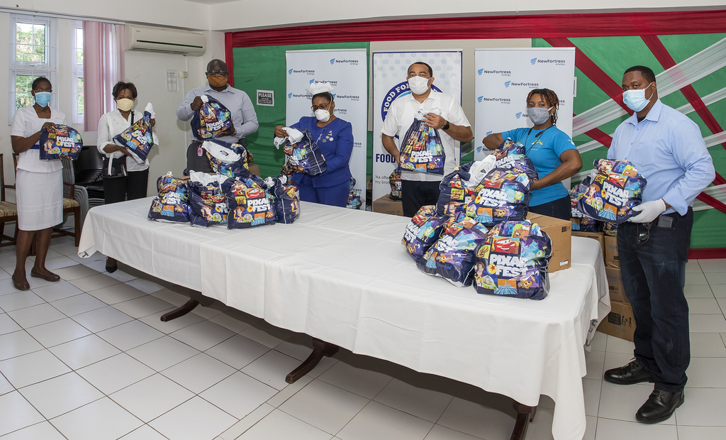 Health minister Dr Christopher Tufton joins New Fortress Energy Foundation in delivering care packages to health care workers at the Spanish Town Hospital on Wednesday April 22. New Fortress Energy Foundation, in partnership with Food for the Poor also delivered care packages to health care workers at the May Pen General Hospital in Clarendon.