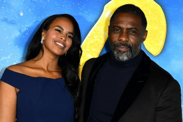 L'acteur britannique Idris Elba et sa femme Sabrina le 17 décembre 2019 à New York afp.com - ANGELA WEISS