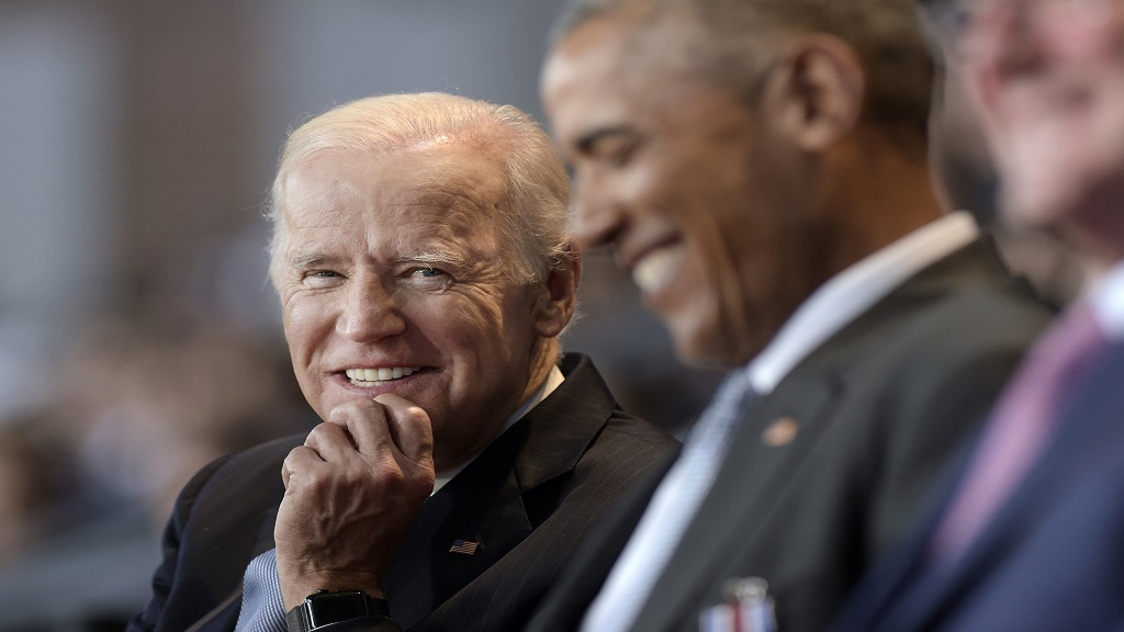 In this January 4, 2017 file photo, Vice President Joe Biden, left, watches President Barack Obama, center, at Conmy Hall, Joint Base Myer-Henderson Hall, Va. (AP Photo/Susan Walsh)