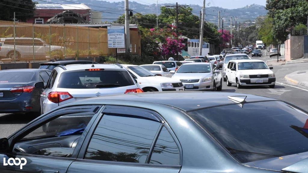 The scene at Mary Brown's Corner in St Andrew as motorists rush home to beat the 3pm curfew on Saturday. (Photos: Marlon Reid)