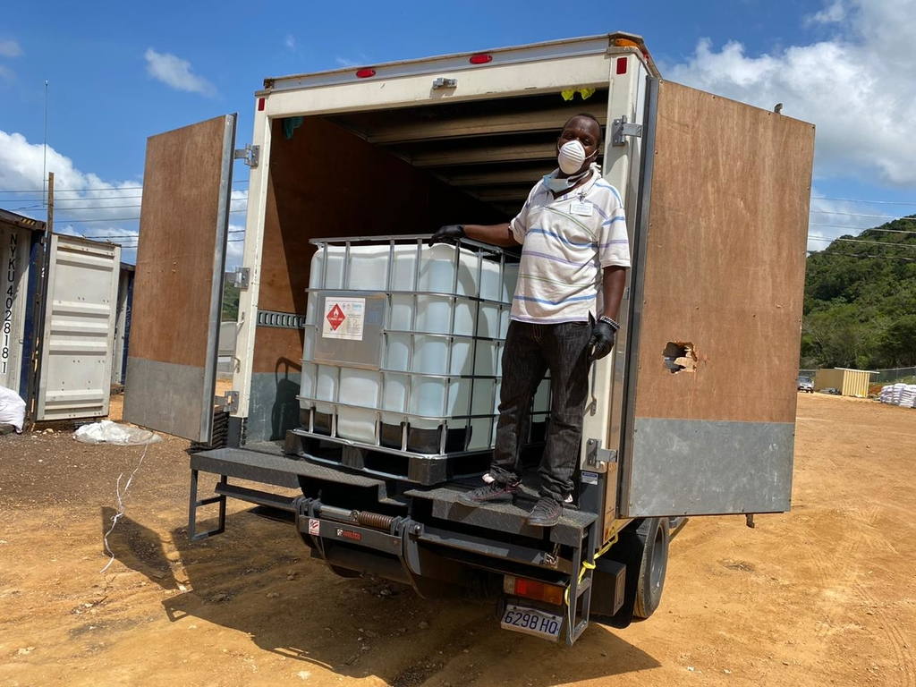 A representative from the Ministry of Health collects the donation of 270 gallons of organic non-denatured alcohol from OGH's Farm in Trelawny. The alcohol will be used to manufacture well-needed hand sanitizers to help the health sector to contain the spread of COVID-19 .