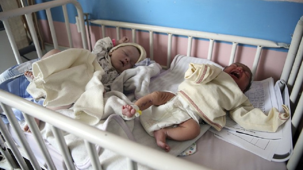 Newborn babies lie in their beds at the Ataturk Children's Hospital a day after they were rescued from a deadly attack on another maternity hospital, in Kabul, Afghanistan, Wednesday, May 13, 2020. (AP Photo/Rahmat Gul)
