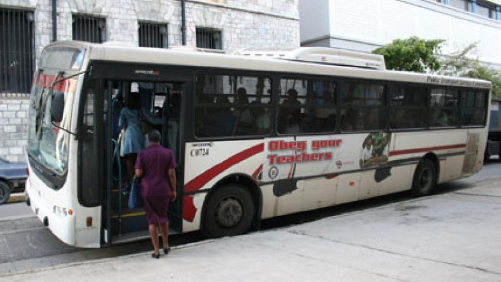 File photo. Passengers board a Public Transport Service Corporation (PTSC) bus.